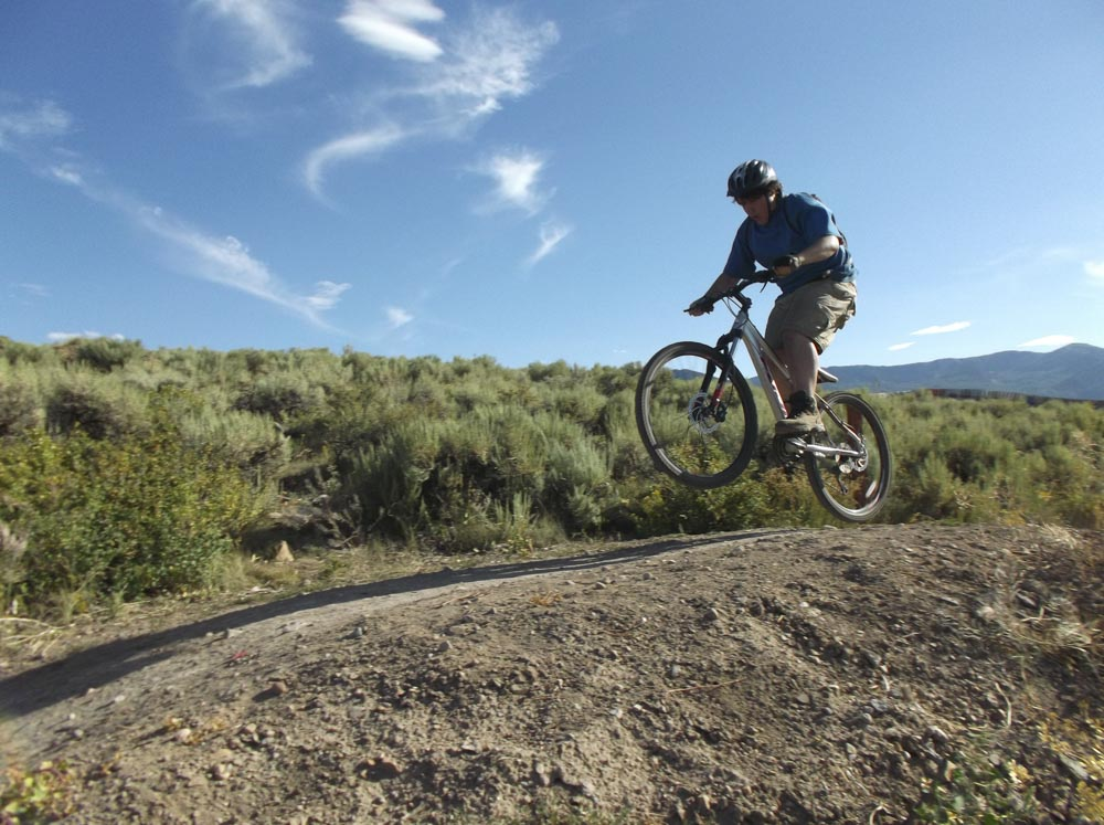 A student mountain bikes while attending Aspiro Wilderness Adventure Therapy program