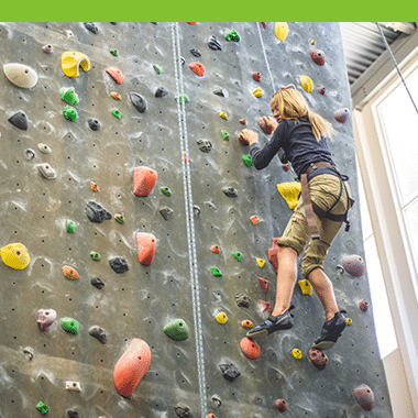 Female Aspiro student using indoor climbing wall