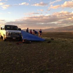 Aspiro students putting a tent up beside a van