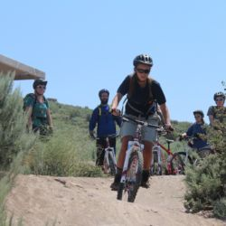 Aspiro student on mountain bike