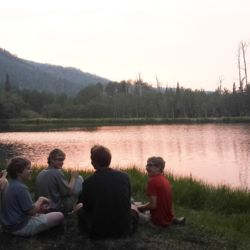 Aspiro students sitting by a lake