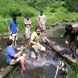 Aspiro students playing in river
