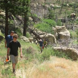 Aspiro students walking uphill in wilderness