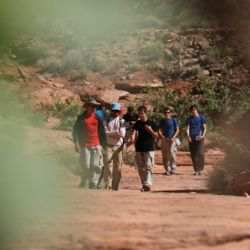 Aspiro students hiking through the wilderness