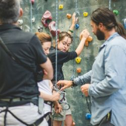 Aspiro students and parents experience an indoor climbing wall